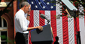 President Barack Obama wipes his face on a hot summer's day as he makes a speech on climate change at Georgetown University, Washington DC, Tuesday, June 25, 2013. <br /> Credit: Dennis Brack / Pool via CNP