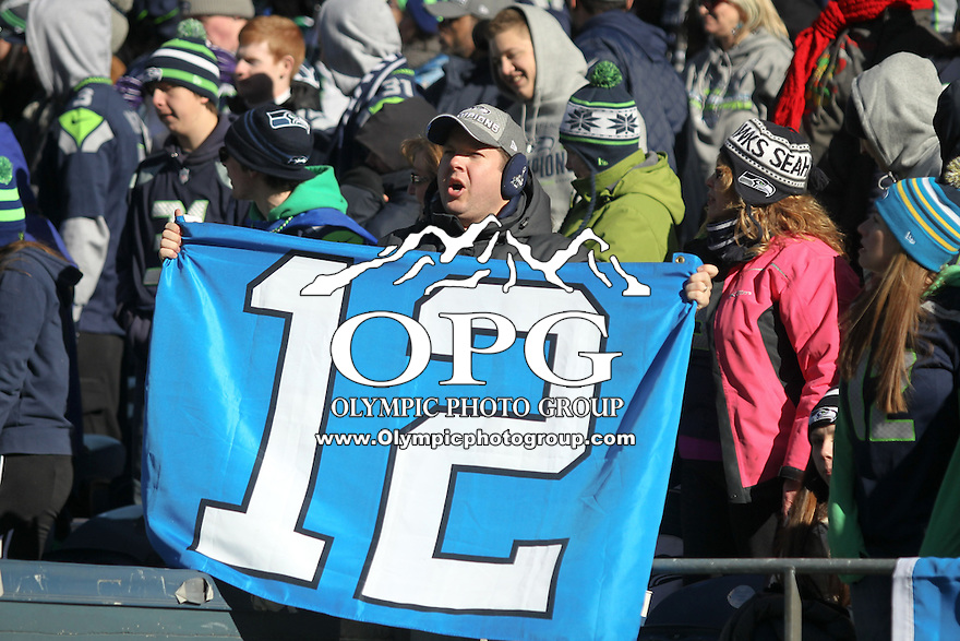 2014-02-05:  Seattle Seahawks players and 12th man fans celebrated bringing the Lombardi trophy home to Seattle during the Super Bowl Parade at Century Link Field in Seattle, WA.