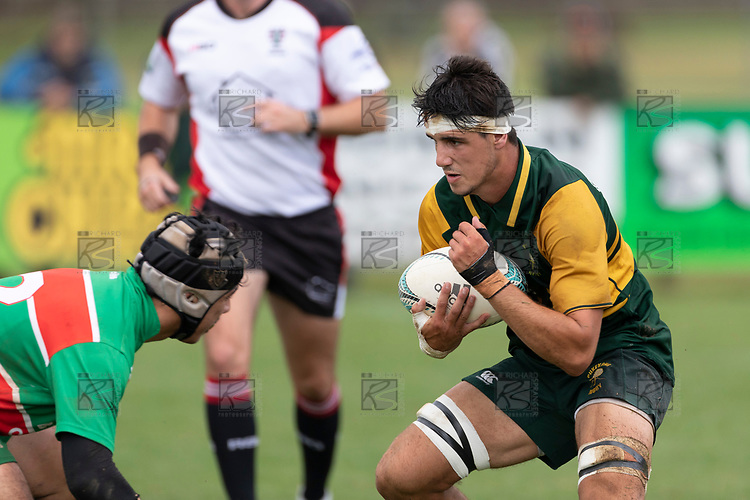James Orr makes a run at Kalapu Palelei. Counties Manukau Premier Club rugby game between Pukekohe and Waiuku, played at Colin Lawrie Fields, Pukekohe on Saturday April 14th, 2018. Pukekohe won the game 35 - 19 after leading 9 - 7 at halftime.<br /> Pukekohe Mitre 10 Mega -Joshua Baverstock, Sione Fifita 3 tries, Cody White 3 conversions, Cody White 3 penalties.<br /> Waiuku Brian James Contracting - Lemeki Tulele, Nathan Millar, Tevta Halafihi tries,  Christian Walker 2 conversions.<br /> Photo by Richard Spranger