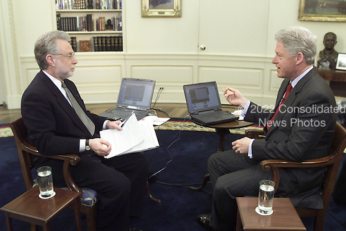 Wolf Blitzer of CNN interviews United States President Bill Clinton in the Oval Office of the White House in Washington, D.C. on February 14, 2000..Mandatory Credit: Ralph Alswang / White House via CNP