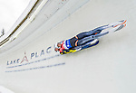 5 December 2014:  Paul Ifrim and Andrei Anghel, sliding for Romania, bank into Curve 10 on their second run, ending the day with a 14th place finish and a combined 2-run time of 1:29.518 in the Men's Doubles Competition at the Viessmann Luge World Cup, at the Olympic Sports Track in Lake Placid, New York, USA. Mandatory Credit: Ed Wolfstein Photo *** RAW (NEF) Image File Available ***