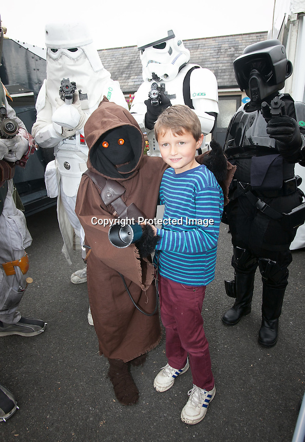 ***NO FEE PIC ***<br /> 14/09/2014<br /> Members of Emerald Garrison with Conor Neurohr 7 from Laytown ***NO FEE PIC ***<br /> 14/09/2014<br /> (L to R) Ray Rennick from Trim, <br /> Hilary Rennick from Trim &amp; <br /> Gerry Macken from Athlone  during a charity lunch for Childhood Cancer Foundation Light it Up Gold campaign at the Curragh Racecourse, Kildare as part of the Irish Champions Weekend.<br /> Photo: Gareth Chaney