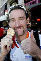 03 SEP 2006 - LAUSANNE, SUI - Tim Don poses with his gold medal after winning the Elite Mens World Triathlon Championships .(PHOTO (C) NIGEL FARROW)