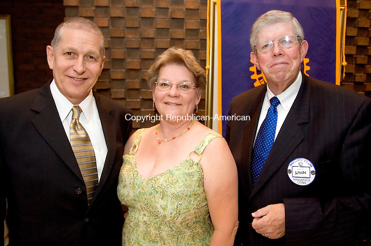 WATERBURY, CT--27 JUNE 2007--062707JS04-Incoming Rotary President Chuck Beebe, left, with his wife Carol Beebe, center and Rotary President Elect John Ford, at the Naugatuck Rotary Club's annual meeting at the Waterbury Club.<br /> Jim Shannon/Republican-American
