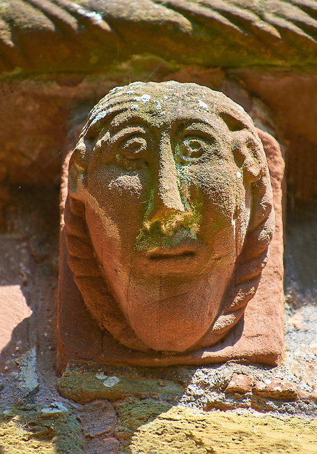 Norman Romanesque exterior corbel no 78 - sculpture of mans head with elongated face from the outside of the west knave. The Norman Romanesque Church of St Mary and St David, Kilpeck Herefordshire, England. Built around 1140