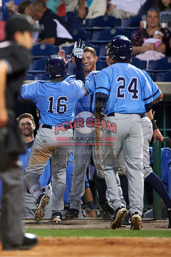 Charlotte Stone Crabs third baseman Cristian Toribio (16) high fives teammates including Grant Kay (2) after a home run during a game against the Clearwater Threshers on April 12, 2016 at Bright House Field in Clearwater, Florida.  Charlotte defeated Clearwater 2-1.  (Mike Janes/Four Seam Images)