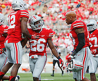 Ohio State Buckeyes cornerback Doran Grant (12) and linebacker Ryan Shazier (10) congratulate cornerback Armani Reeves (26) following his interception during the NCAA football game at Ohio Stadium in Columbus on Sept. 7, 2013. (Adam Cairns / The Columbus Dispatch)