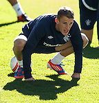 Dean Shiels balancing on the ball and having a stretch