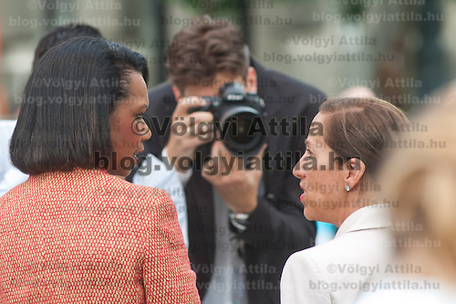 Condoleezza Rice (L) and Eleni Tsakopoulos Kounalakis (R) talk to each other surrounded by photographers before the inauguration of the new statue of Ronald Reagan on the square named Freedom in Budapest, Hungary. Wednesday, 29. June 2011. ATTILA VOLGYI
