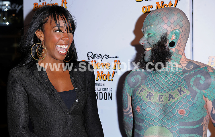 **ALL ROUND PICTURES FROM SOLARPIX.COM**.**WORLDWIDE SYNDICATION RIGHTS**.The stars and celebs attend the grand opening of the new Ripleys beleive it or not, Museum in Piccadilly circus in London..This pic:,Kelly Rowland,Lizard Man..JOB REF:7195-SSD     DATE:03_09_08.**MUST CREDIT SOLARPIX.COM OR DOUBLE FEE WILL BE CHARGED* *UNDER NO CIRCUMSTANCES IS THIS IMAGE TO BE REPRODUCED FOR ANY ONLINE EDITION WITHOUT PRIOR PERMISSION*