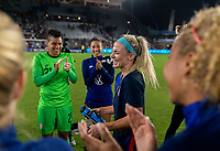ORLANDO, FL - MARCH 05: Julie Ertz #8 of the United States celebrates her 100th cap during a game between England and USWNT at Exploria Stadium on March 05, 2020 in Orlando, Florida.
