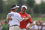 Lee Westwood hugs his caddy on the 18th green after winning the Dubai World Championship Golf in Jumeirah, Earth Course, Golf Estates, Dubai  UAE, 22nd November 2009 (Photo by Eoin Clarke/GOLFFILE)