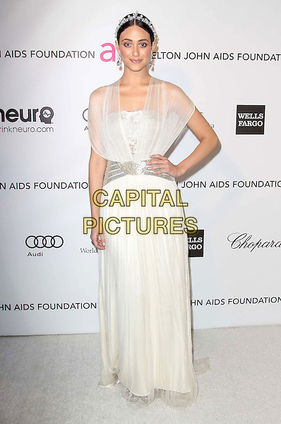 Emmy Rossum.The 21st Annual Elton John AIDS Foundation Academy Awards Viewing Party held at The City of West Hollywood Park in West Hollywood, California, USA..February 24th, 2013.oscars full length dress white sheer blue pearls silver belt hairband hand on hip.CAP/ADM/KB.©Kevan Brooks/AdMedia/Capital Pictures.