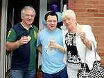 Liam, Barry and Ann Smith enjoying an ice cream at the HB Down Syndrome day at Rathmullen Community house. Photo:Colin Bell/pressphotos.ie