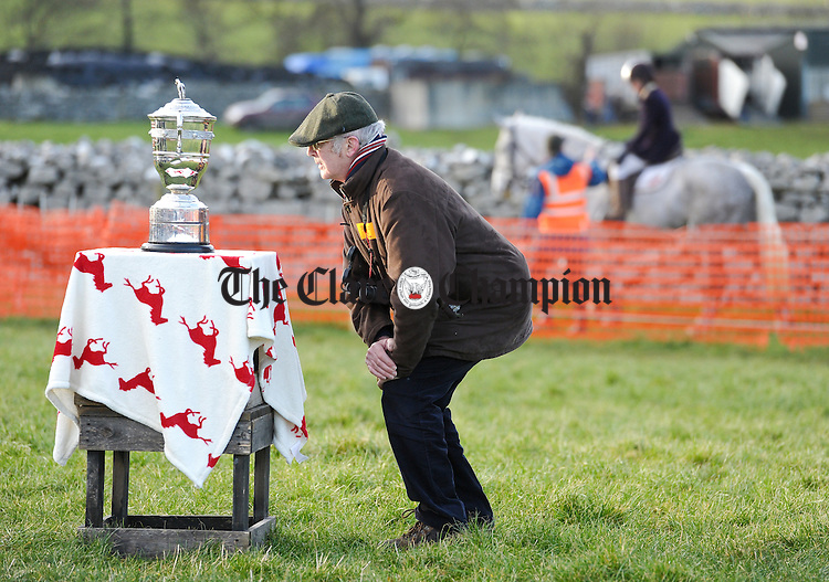 Clare hunt member pat Stafford having a close look at the roll of honour on the Brady Brown Cup before the Mad hatters race during the Clare Hunt annual Point to Point at Bellharbour. Photograph by John Kelly.