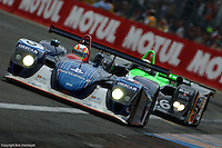 The Dallara Oreca Judd driven by Olivier Beratta, Pedro Lamy and Eric Comas leads the MG Lola of Anthony Reid, Warren Hughes and Jonny Kane during the 2002 24 Hours of Le Mans.