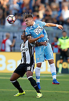 Calcio, Serie A: Lazio vs Juventus. Roma, stadio Olimpico, 27 agosto 2016.<br /> Juventus&rsquo; Mario Lemina, left, and Lazio's Ciro Immobile fight for the ball during the Serie A soccer match between Lazio and Juventus, at Rome's Olympic stadium, 27 August 2016. Juventus won 1-0.<br /> UPDATE IMAGES PRESS/Isabella Bonotto