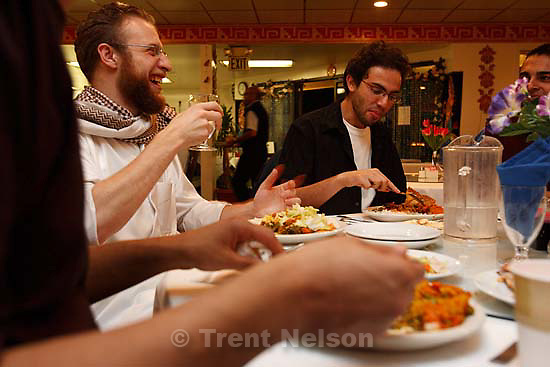 Salt Lake City - Anwar Arafat (left) and Mohanad Mossalam eat and laugh as approximately fifty members of the Muslim Students Association of the University of Utah held a group Iftar (breaking the fast) at Taj India. Trent Nelson/The Salt Lake Tribune; 10.05.2007Salt Lake City - About fifty members of the Muslim Students Association of the University of Utah held a group Iftar (breaking the Ramadan fast) at Taj India.