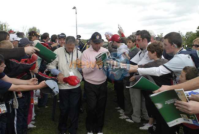 Jose Maria Olazabal signs autographs for the huge enthusiastic crowd on his way to the 16th tee during Practice Day1 of the 2006 Ryder Cup at The K Club Saturday 19th September 2006.(Photo Eoin Clarke/Newsfile)