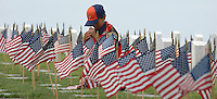 Saturday, May 22, 2009.  Fort Rosecrans National Cemetery, San Diego California, USA:  Tiger Scout Nicholas Sandoval (7) of Chula Vista Troop 151 places a flag at a gravesite in Fort Rosecrans National Cemetery.  Hundreds of boy scouts, girl scouts and their parents fanned out across the cemetery to plant flags at each grave site to mark Memorial Day..
