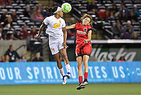 Portland, Oregon - Sunday September 11, 2016: Western New York Flash forward Jessica McDonald (14) heads the ball past Portland Thorns FC defender Emily Menges (4) during a regular season National Women's Soccer League (NWSL) match at Providence Park.