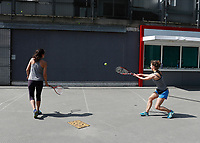 9th May 2020, Emirates  Stadium, London, England; Two women playing tennis outside the Emirates Stadium  during the Covid-19 lockdown