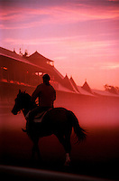 ©Mitch Wojnarowicz Photographer.Saratoga Springs NY Exercise riders take a horse for a morning workout at sunrise at the thoroughbred horse racing track here..20030823.Not a royalty free image. COPYRIGHT PROTECTED.www.mitchw.com.www.mitchwblog.com.518 843 0414_Mitchw@nycap.rr.com.ANY USE REQUIRES A WRITTEN LICENSE.NO Model release for this image