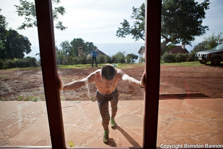 Belgian marathon runner Lander Van Droogenbroeck  stretches after a workout at the Kerio View Inn in Iten, Kenya. Elite athletes from around the world are flocking to Kenya in advance of  the Olympics to try to gain an advantage from the high-altitude training grounds.