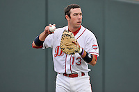 Catcher Austin Rei (13) of the Greenville Drive warms up before a game against the Asheville Tourists on Thursday, April 7, 2016, at Fluor Field at the West End in Greenville, South Carolina. Greenville won, 4-3. (Tom Priddy/Four Seam Images)