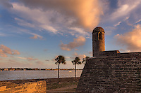 Vibrant sunset over historic Castillo San Marcos, St. Augustine, Florida.