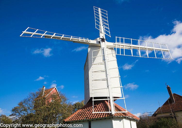 Thorpeness Windmill, Suffolk, England is a post mill built 1803 moved from Aldringham in 1923. It pumped water to the House in the Clouds seen in the background.