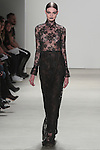 Paulina walks runway in a black plissé lace gown, from the Georgine Fall 2016 collection, by Georgine Rateland at NYFW: The Shows Fall 2016, during New York Fashion Week Fall 2016.