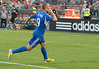 03 July 2013: Montreal Impact forward Marco Di Vaio #9 looks to the Toronto crowd after scoring the third Montreal goal during an MLS game between the Montreal Impact and Toronto FC at BMO Field in Toronto, Ontario Canada.<br /> The game ended in a 3-3 draw.