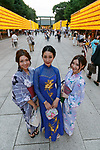 Visitors dressed in traditional Japanese and Vietnamese (C) clothing pose for a photograph during the annual ''Mitama Festival'' at Yasukuni Shrine on July, 13, 2017, Tokyo, Japan. Over 30,000 lanterns are displayed along the entrance of the shrine to help spirits find their way during the annual celebration for the spirits of ancestors. The festival runs until July 16th. (Photo by Rodrigo Reyes Marin/AFLO)