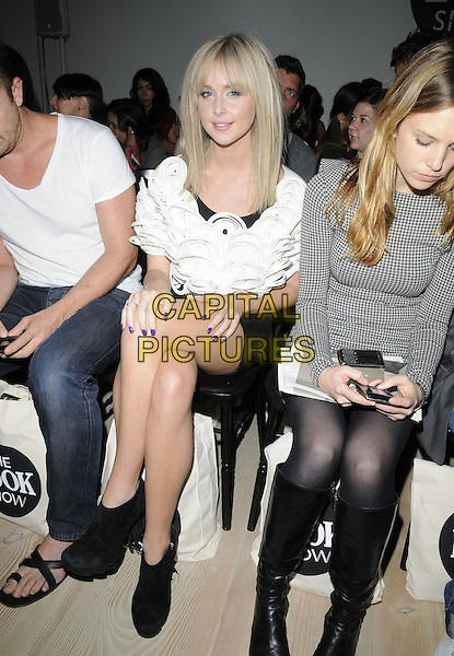 DIANA VICKERS .At the Look magazine High Street Fashion Show during Day 1 of London Fashion Week, Saatchi Gallery, Duke of York Square, Kings Road, London, England, UK, September 17th 2010..LFW full length white top black ankle boots mini dress sitting down string circles texture .CAP/CAN.©Can Nguyen/Capital Pictures