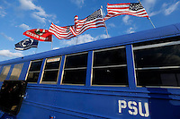 A Penn State bus dons both Penn State and OSU flags before the first quarter of their game at Beaver Stadium in State College, PA on October 25, 2014. (Columbus Dispatch photo by Brooke LaValley)