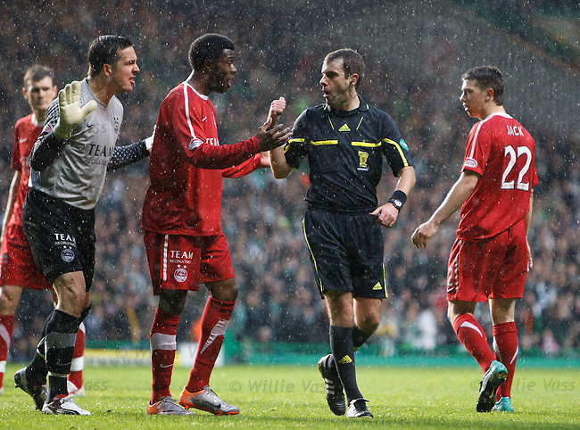Jamie Langfield gets bookes for pulling down Shaun Maloney and escapes a red card