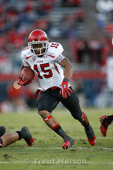 Trent Nelson  |  The Salt Lake Tribune.Utah's John White runs for a touchdown during the first half as Utah faces Arizona, college football at Arizona Stadium in Tucson, Arizona, Saturday, November 5, 2011.