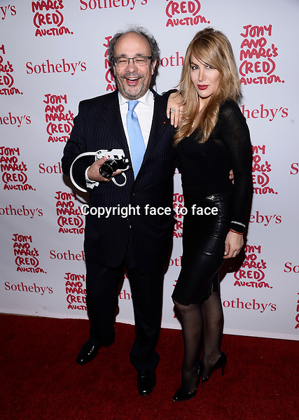 EW YORK, NY - NOVEMBER 23,2013: Andreas Kaufmann (L) and guest pictured at Jony And Marc's (RED) Auction at Sotheby's on November 23, 2013 in New York City<br />