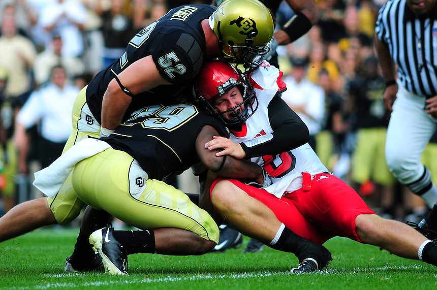 06 September 08: Eastern Washington quarterback Matt Nichols tries to gain a few extra inches against Colorado. The Colorado Buffaloes defeated the Eastern Washington Eagles 31-24 at Folsom Field in Boulder, Colorado. FOR EDITORIAL USE ONLY
