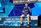 18th March 2018, Arena Birmingham, Birmingham, England; Yonex All England Open Badminton Championships; Shi Yuqi (CHN) receives the winning trophy in the mens singles final against Lin Dan (CHN)