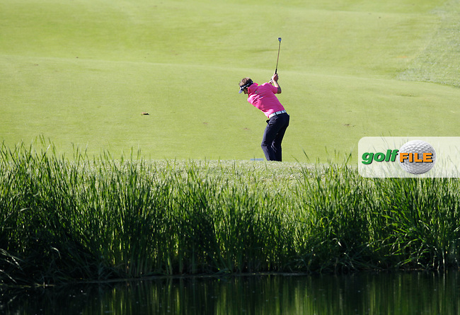 Jbe Kruger (RSA) plays a penalty drop on the 4th hole during Thursday's Round 1 of the 2014 Open de Espana held at the PGA Catalunya Resort, Girona, Spain. Wednesday 15th May 2014.<br /> Picture: Eoin Clarke www.golffile.ie