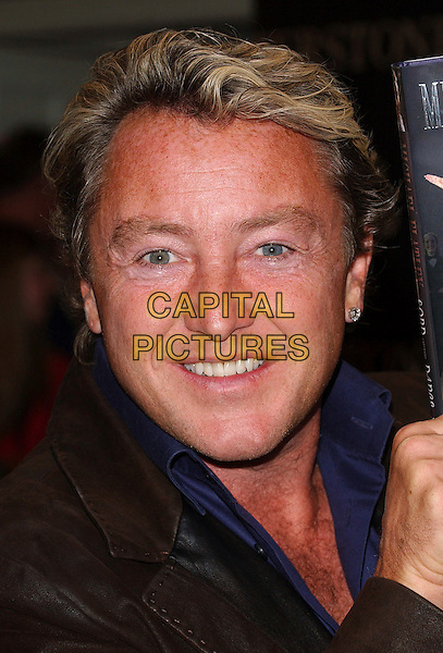 "MICHAEL FLATLEY.signs copies of his autobiography ""Lord Of The Dance: My Story"" at Waterstone's Book Department, Harrods, .London, 4th April 2006 .portrait headshot Booksigning.Ref: BEL.www.capitalpictures.com.sales@capitalpictures.com.© Capital Pictures."