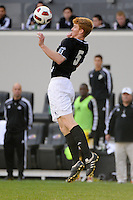 Bryan Minogue (5) of the Providence Friars. The Louisville Cardinals defeated the Providence Friars 3-2 in penalty kicks after playing to a 1-1 tie during the finals of the Big East Men's Soccer Championship at Red Bull Arena in Harrison, NJ, on November 14, 2010.