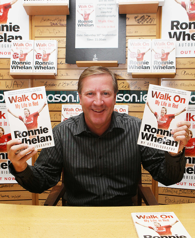 ***NO FEE PIC ***.10/09/2011.Eason Ireland's leading retailer of books , stationery, magazines & lots more hosted a book signing by former Liverpool & Irish international soccer player Ronnie Whelan..Pictured at Eason O' Connell street, Dublin is Ronnie Whelan signing copies of his new autobiography WALK ON for fans..Follow Eason on twitter- @easons..Photo: Collins