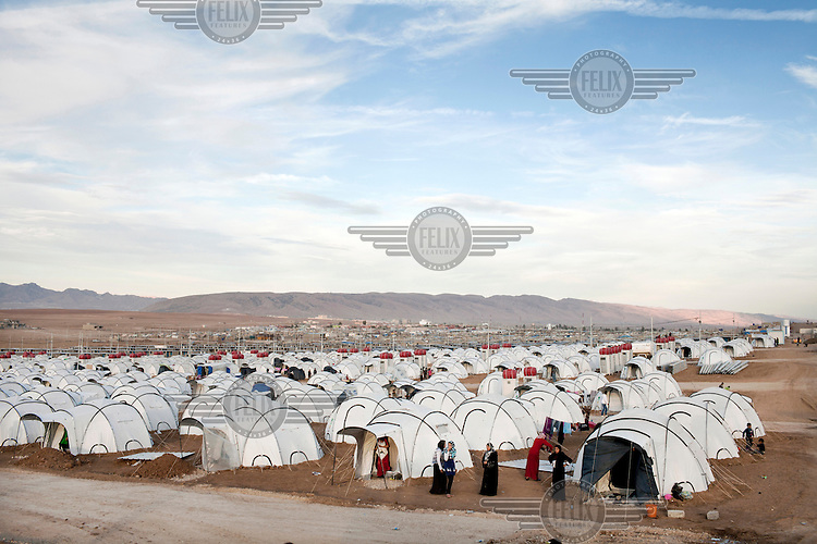 A group of Syrian refugee women beside the tents at Domiz Refugee Camp.