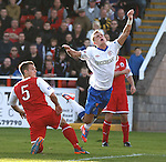 Dean Shiels' late effort on goal is deflected wide and he goes flying over the leg of Gary Thom