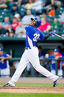 James Baldwin (37) of the Great Lakes Loons follows through on his swing against the West Michigan Whitecaps at the Dow Diamond on June 11, 2013 in Midland, Michigan.  The Loons defeated the Whitecaps 13-6.  (Brian Westerholt/Four Seam Images)