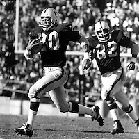 Oakland Raider Cornerback Jimmy Warren streaks for the endzone for Touchdown after interception.<br /> following is Horace Jones. (1971 photo by Ron Riesterer)