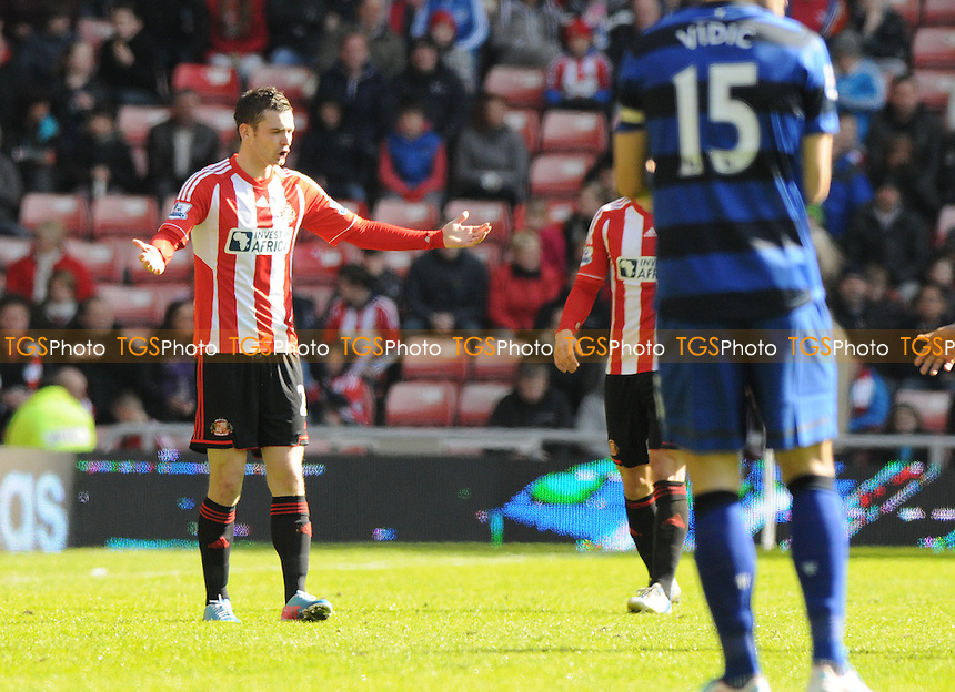 Sunderland's Adam Johnson complains to the referee - Sunderland vs Manchester United - Barclays Premier League Football at The Stadium of Light, Sunderland, Tyne & Wear - 30/03/13 - MANDATORY CREDIT: Steven White/TGSPHOTO - Self billing applies where appropriate - 0845 094 6026 - contact@tgsphoto.co.uk - NO UNPAID USE